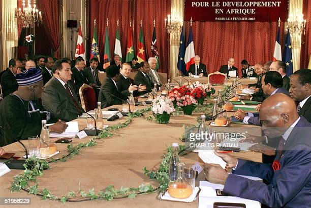 Thirteen African heads of State and Government gather at the Elysee Palace in Paris with French President Jacques Chirac 08 January 2002 The leaders...