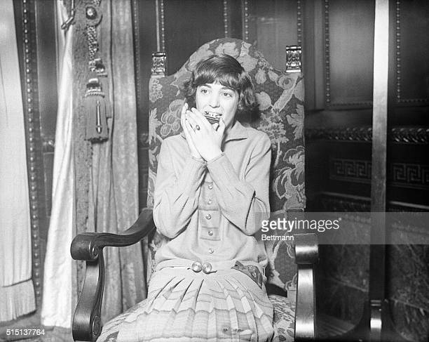 Thirteen year old Etta Silas making the harmonica Talk in Philadelphia Mayors reception room at City Hall where she won girls' second annual...