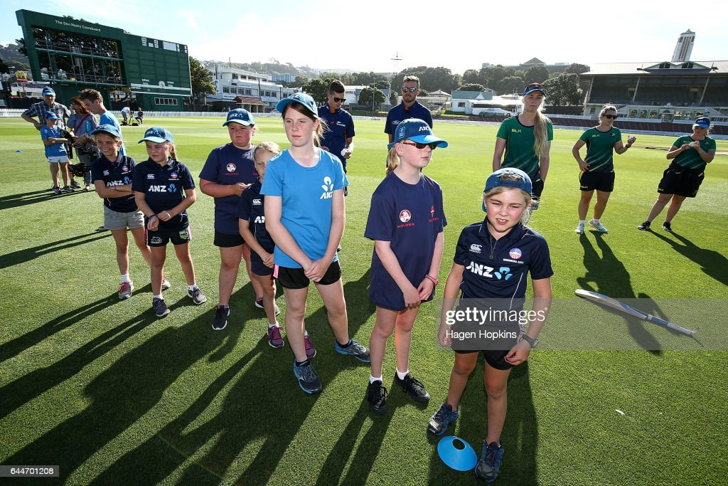Thirteen-year-old Erin Buckland who is 'flying the flag' for females in cricket looks on with teammates during the ANZ Dream Deliveries programme at Basin Reserve on February 23, 2017 in Wellington, New Zealand.