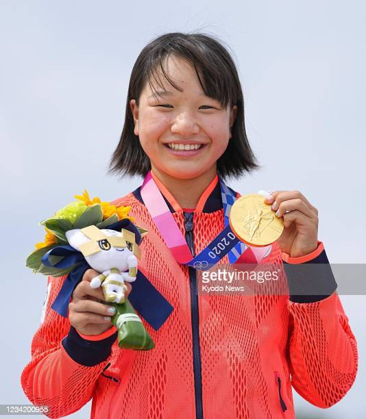 Thirteen-year-old Japanese skateboarder Momiji Nishiya celebrates after winning the women's street gold medal at the Tokyo Olympics on July 26 at...