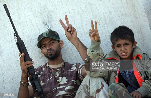 Thirteenyearold Naseem accompanies his father daily to the front line in Sirte on October 18 where fighting is intense in two neighbourhoods Naseem...