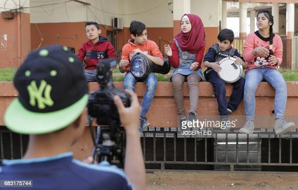 Thirteenyearold Syrian refugee Hanadi alHajj Abdallah from the Syrian town of Minbej sings with freinds while being filmed in Beirut's southern...