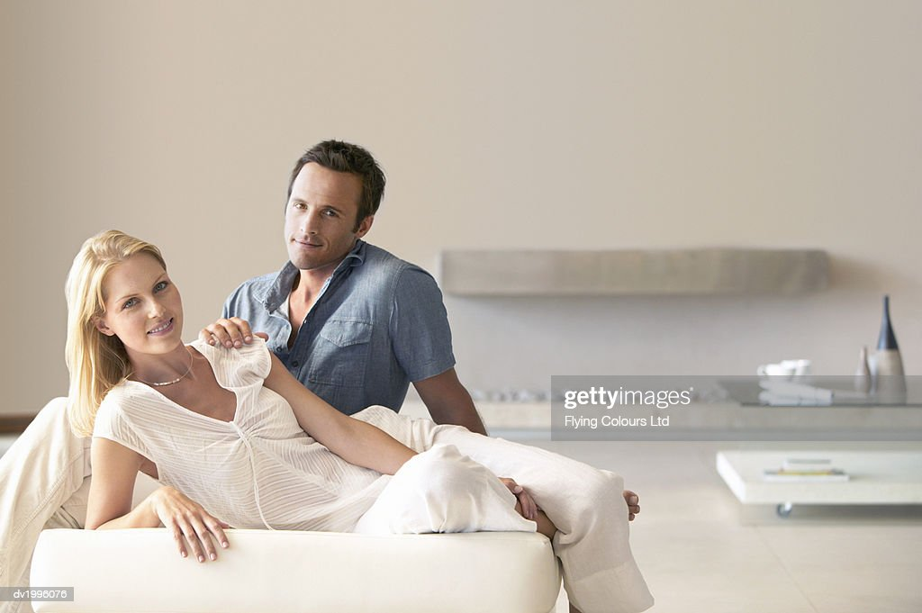Thirty something Couple Sitting in a Modern Living Room : Stock Photo