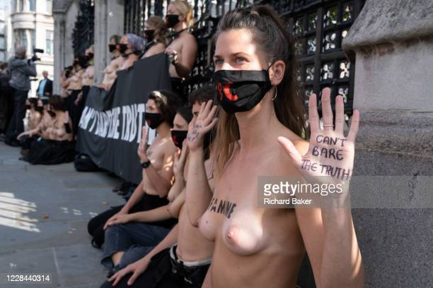 Thirty topless women supporters of Climate Change activists, Extinction Rebellion protest outside the UK parliament railings, on 10th September 2020,...