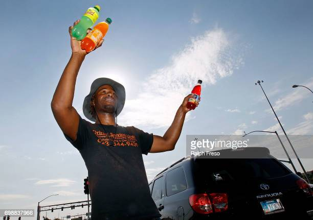 Thirtythree year old Eric Maurice Clark sells cold bottled drinks to drivers at a busy intersection on June 20 2017 in Phoenix Arizona Record...