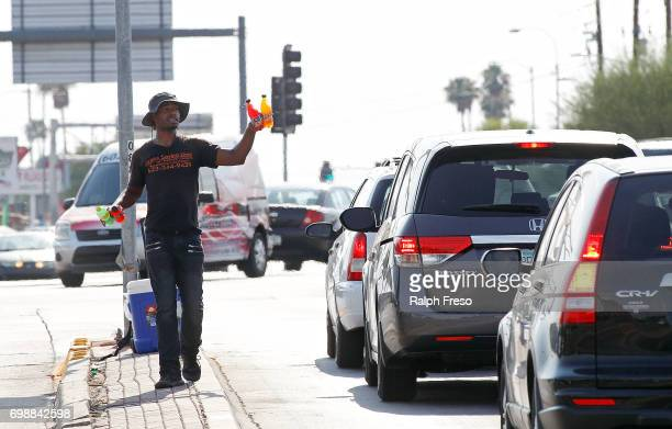 Thirtythree year old Eric Maurice Clark sells cold bottled drinks to motorist at a busy intersection on June 20 2017 in Phoenix Arizona Record...