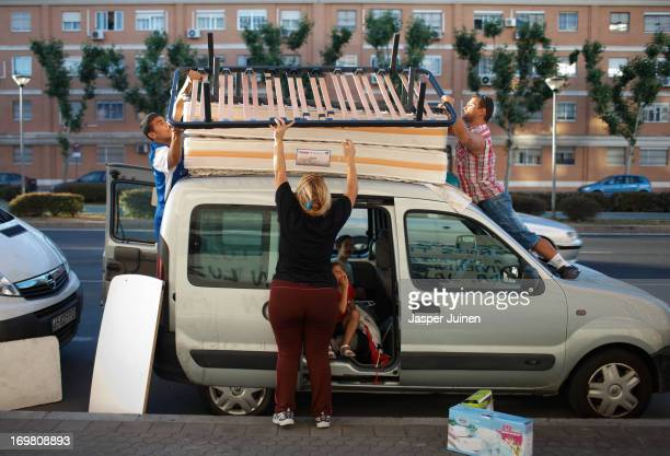 Thirty-three year old Vanessa Arias Fernandez , who was evicted from her home together with her family, helps her twenty-seven year old husband Juan...