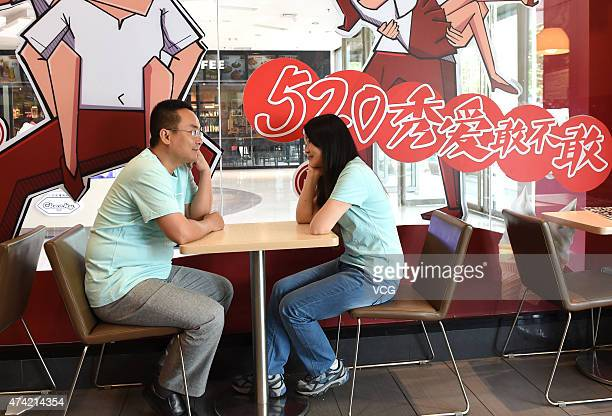 Thirty-year old couple before makeup on Network Valentine's Day on May 20, 2015 in Zhengzhou, Henan province of China. A couple of lovers over thirty...