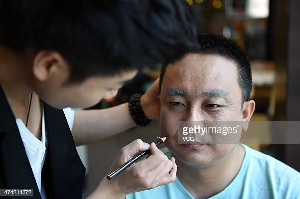 Thirty-year old husband in makeup on Network Valentine's Day on May 20, 2015 in Zhengzhou, Henan province of China. A couple of lovers over thirty...