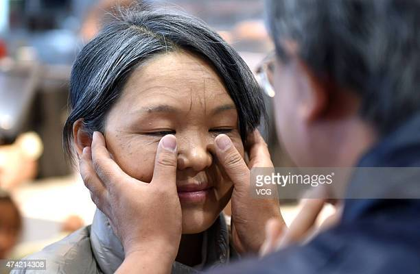 """Thirty-year old husband wipes tears for his wife in their in """"Seventy-year"""" old on Network Valentine's Day on May 20, 2015 in Zhengzhou, Henan..."""