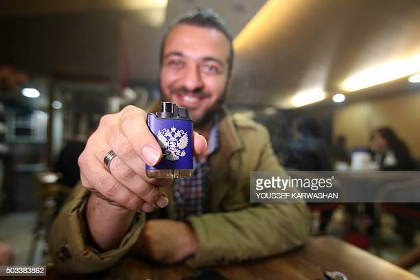 Thirtyyearold Syrian Tarek Shaabo who owns the 'Moscow Cafe' coffee shop in the Syrian coastal city of Latakia where Russian clients drink for free...