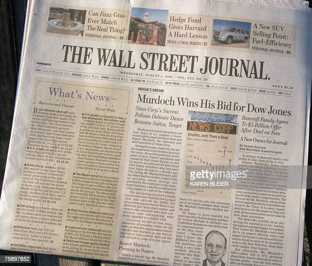 This 01 August 2007 photo taken in Washington DC shows the front page of the Wall Street Journal announcing media tycoon Rupert Murdoch's win in his...