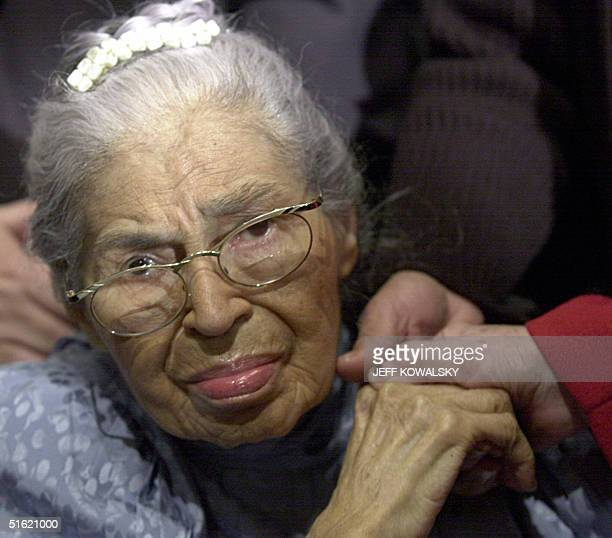 This 01 December 2001 file photo shows US civil rights legend Rosa Parks attending at the Henry Ford Museum in Dearborn Michigan during a ceremony...