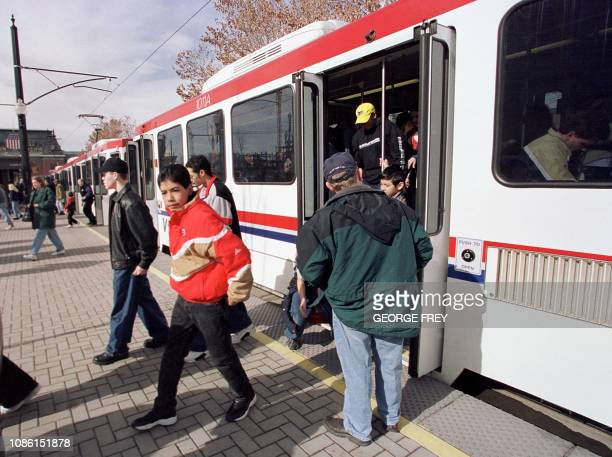 This 01 February 2001 photo shows people as they exit a newly built lightrail system in Salt Lake City that will be used for transportation for the...