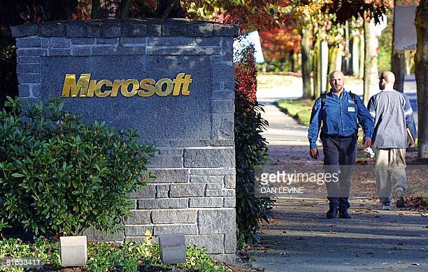 This 01 November file photo shows Redmond Washington residents passing one of the entrances to the Microsoft Corporation campus Microsoft agreed 29...