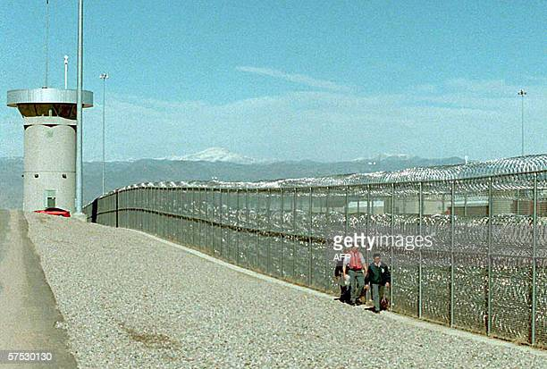 This 02 February file photo shows guards walking along the fence at the super-maximum-security federal prison in Florence, Colorado. Al-Qaeda plotter...