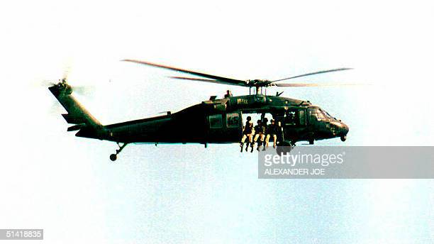 This 02 September file photo shows a US UH60 Black Hawk helicopter in Somalia A US army UH60 carrying 15 people went missing 11 March near Fort Drum...