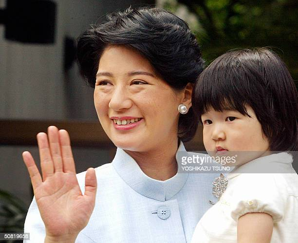 This 04 September 2003 file picture shows Japanese Princess Masako holding her daughter Princess Aiko Japanese Crown Prince Naruhito tacitly...