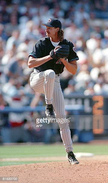 This 05 April 1999 file photo shows Arizona Diamondbacks pitcher Randy Johnson winding up to throw a pitch during a game against the Los Angeles...