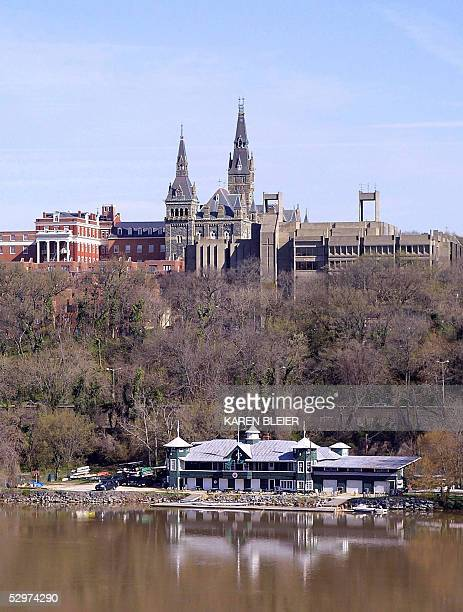 This 05 April, 2005 view shows the spires of Healy Hall and the Washington Canoe Club on the Georgetown University campus next to the Potomac River...