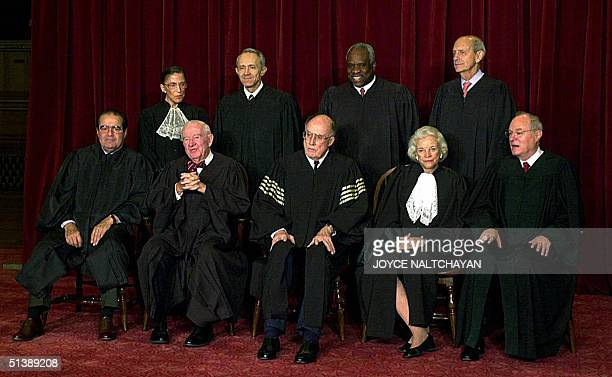 This 05 December 2003 shows the justices of the Supreme Court of the United States posing for an official photo at the Supreme Court in Washigton DC...