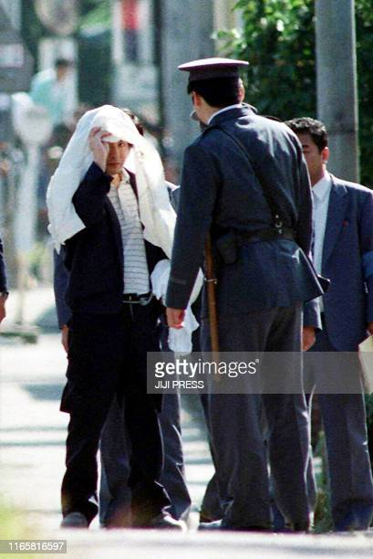 This 05 October 1989 file picture shows Tsutomu Miyazaki at an inspection of a murder case as he was convicted of killing four young girls and eating...