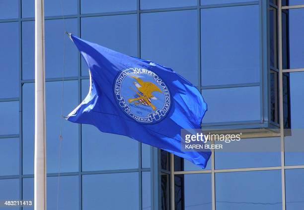 This 06 April 2005 photo shows the flag of the National Rifle Association flying in front of the institution's headquarters in Fairfax Virginia For...