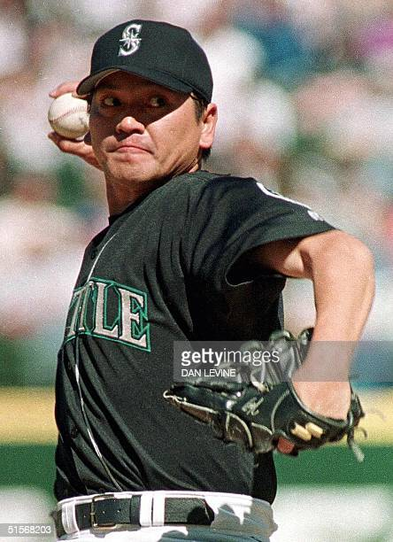 This 06 May 2000 file photo shows Seattle Mariner pitcher Kazuhiro Sasaki pitching in the top of the ninth inning against the Anaheim Angels in...