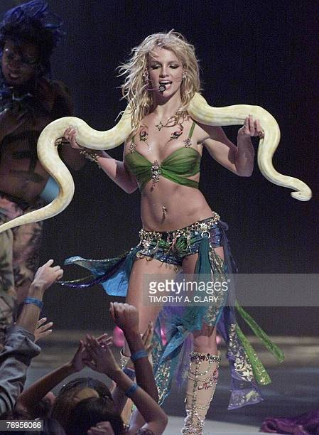 This 06 September 2001 file photo shows US pop star Britney Spears performing with a snake draped over her shoulders at the 2001 MTV Video Music...