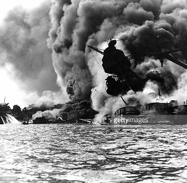 This 07 December 1941 file photo obtained from the US Naval Historical Center shows the USS Arizona sunk and burning furiously Her forward magazines...
