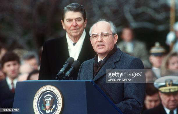 This 08 December1987 photo shows US President Ronald Reagan with Soviet leader Mikhail Gorbachev during welcoming ceremonies at the White House on...