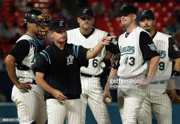 This 11 August 2001 file photo shows Florida Marlins manager John Boles on the mound with catcher Ramon Castro shortstop Andy Fox pitcher AJ Burnett...