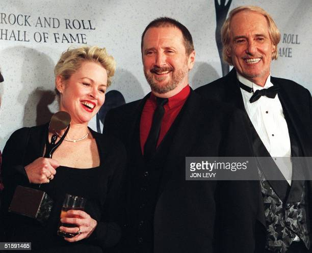 This 12 January 1998 file photo shows members of the rock group The Mamas and the Papas Michelle Phillips Denny Doherty and John Phillips after...