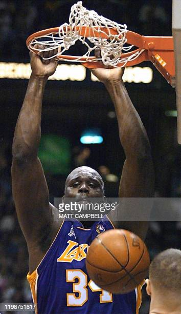 This 12 June 2002 file photo shows Shaquille O'Neal of the Los Angeles Lakers hanging from the rim after a dunk against the New Jersey Nets in the...