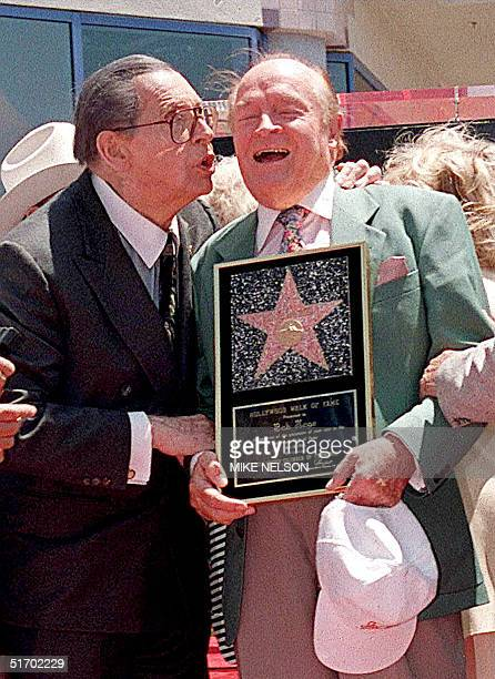 This 13 May file photo shows US comedian Bob Hope getting kissed by US comedian Milton Berle after Hope received a Star on the Hollywood Walk of Fame...