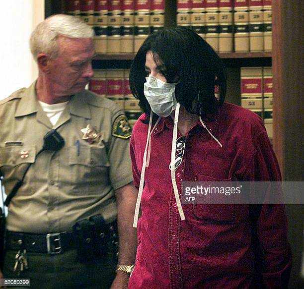 This 13 November file photo shows pop singer Michael Jackson arriving inside the Santa Maria Superior Court for a trial in which he is accused of...