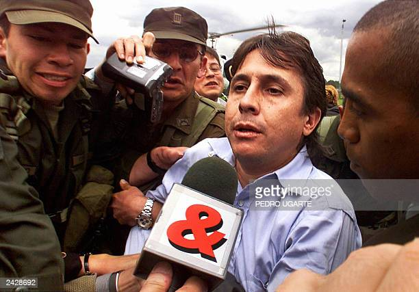 This 13 October 1999 file photo shows Colombian drug trafficker Fabio Ochoa being escorted by police as he arrives in Bogota shortly after his...