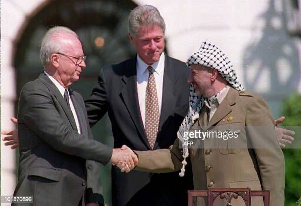 This 13 September 1993 file photo shows US President Bill Clinton standing between PLO leader Yasser Arafat as he shakes hands with Israeli Prime...
