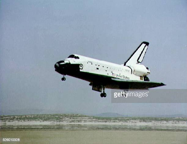 This 14 April 1981 NASA file photo shows the Space Shuttle Columbia landing with mission commander John Young and pilot Robert Crippen on board at...