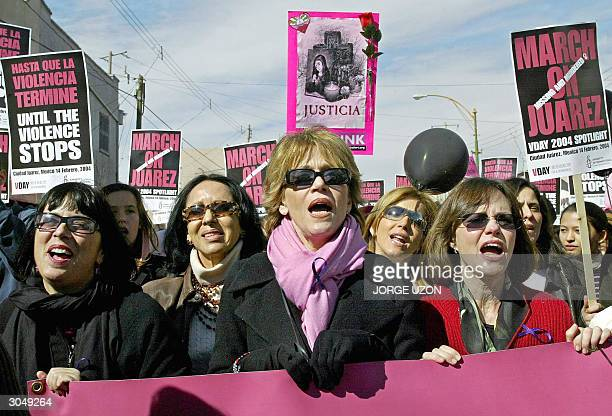 This 14 February 2004 picture shows US Dramatist Eve Ensler and US actresses Jane Fonda and Sally Field demonstrating for violence against women in...