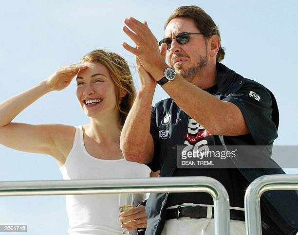 This 16 January 2003 file photo shows Larry Ellison owner and team head of OracleBMW racing's yacht 'USA76' with his fiancee romance writer Melanie...