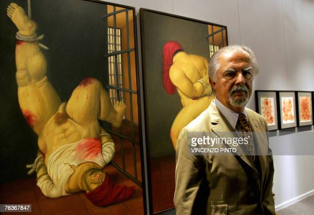 This 16 June 2005 file photo shows Colombian artist Fernando Botero posing in front of one of his paintings inspired by the prison abuse scandal at...
