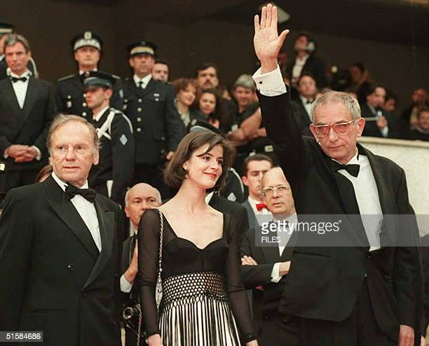 This 16 May 1994 file photo shows Polish film director Krzysztof Kieslowski waving to fans from the steps of the Palais des festivals in Cannes...