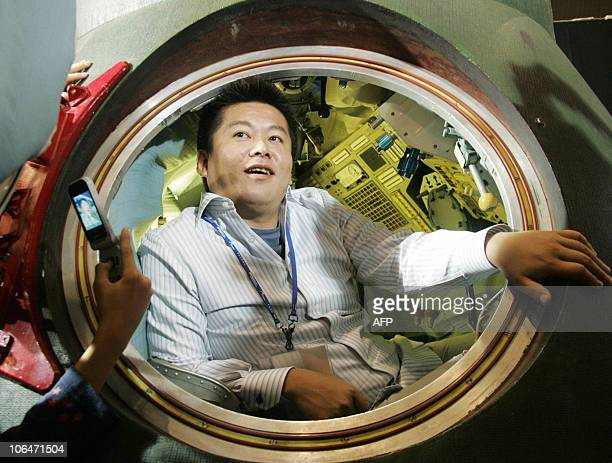 This 16 October 2005 file picture shows Takafumi Horie President of Japan's internet firm Livedoor in a space capsule from the manned Russian...