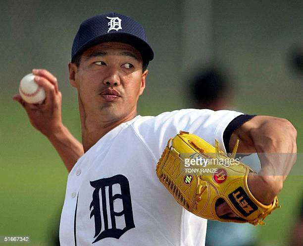 This 18 February file photo shows Japanese pitcher Masao Kida then with the Detroit Tiger warming up before the start of Spring training camp at...