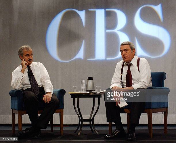 This 18 October 2001 file photo shows CBS anchor Dan Rather and CBS news division president Andrew Heyword speaking at news conference in New York...