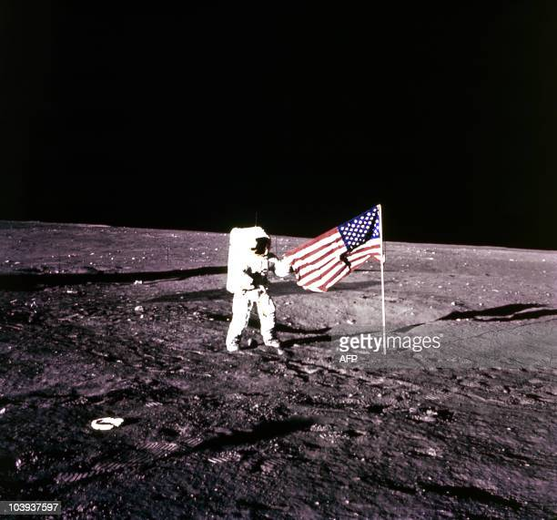 This 19 November 1969 file photo released by NASA shows Apollo 12 Astronaut Charles 'Pete' Conrad standing by the US flag on the Moon An Apollo /...