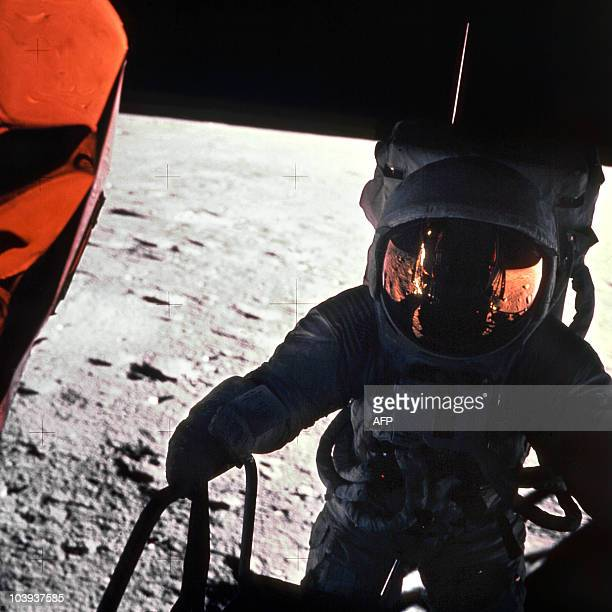 This 19 November 1969 file photo released by NASA shows one of the astronauts of the Apollo 12 space mission on the Moon with a camera An other...