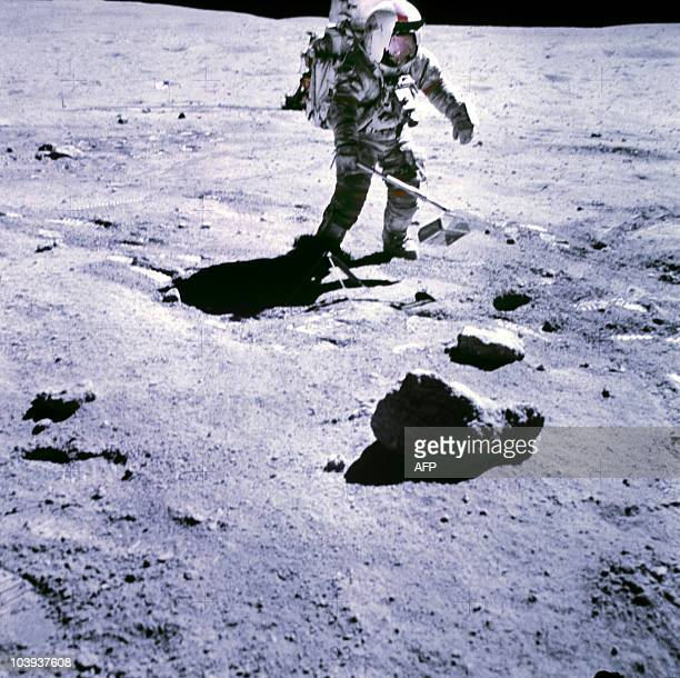 This 19 November 1969 file photo released by NASA shows one of the astronauts of the Apollo 12 space mission conducting experiments on the moon's...
