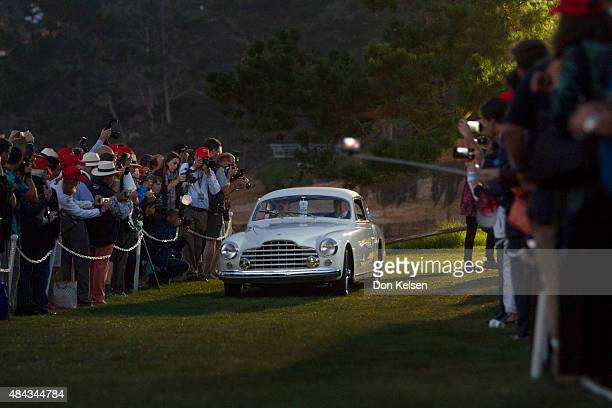 This 1950 Ferrari 195 INTER Ghia Coupe from Desselgem Belgium opens the parade of classics predawn Sunday morning onto the 18th green at The Lodge at...